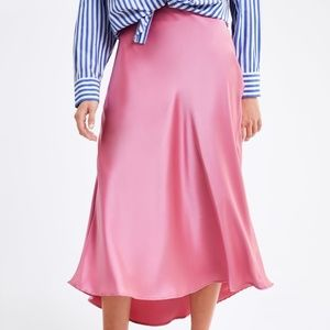 Pink asymmetrical hem satin skirt